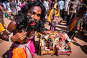 Indian man in traditional outfit piercing his lip during Shivaratri festival in the street in Gokarna, Karnataka, India, on February 19, 2015. Hindus across the country celebrate Mahashivratri, better known as Lord Shiva's wedding anniversary. Lord Shiva is also known as Nataraja, the Lord of Dancers.<br />