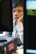 Seattle, Washington; June 14, 2012. Middle school student concentrates on a math computer program in the school computer lab.