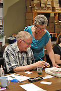 Canada, Ontario Windsor, 2016. Artist Trading Card workshop at Ten Thousand Villages is a MayWorks Windsor 2016 event. Gord Taylor and Joan Murphy-Walker talk about card making.