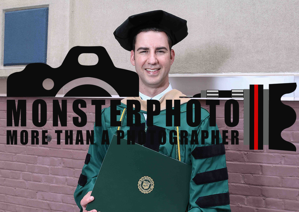 Doctoral degree Candidate Jeremy I. Campbell pose for a photo after Wilmington University commencement exercise Sunday, May 17, 2015, at Chase Center On The Riverfront in Wilmington Delaware.