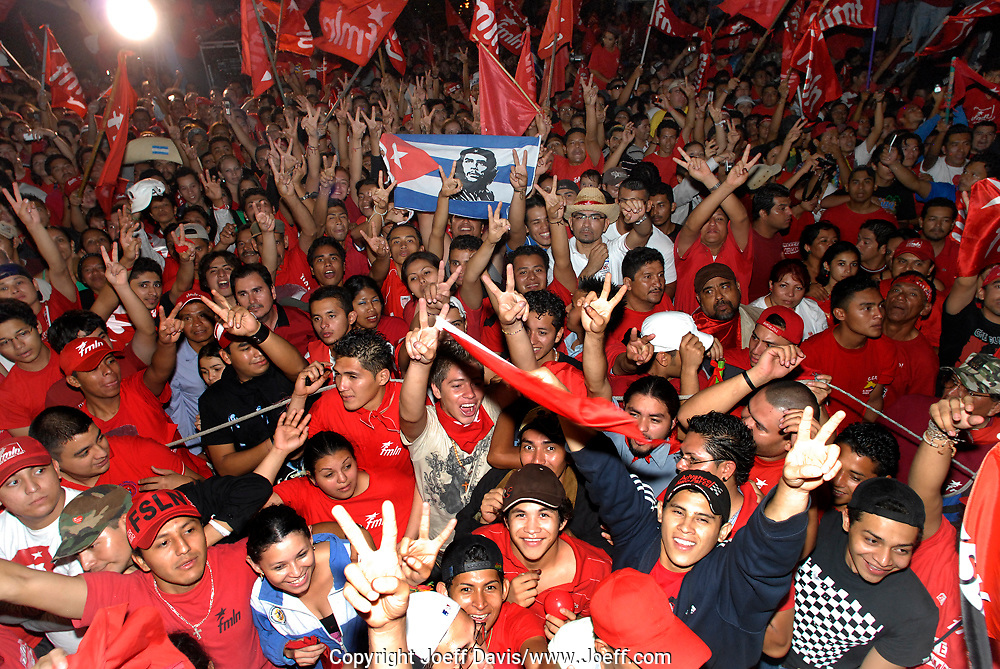 March 15, 2009 - San Salvador, El Salvador: The FMLN victory party  at Masferrer Plaza. The crowd was celebrating the election of former journalist Mauricio Funes of the FMLN party who became the first leftist president in El Salvador's history. <br /> <br /> The FMLN became a political party after the 1992 peace agreement which ended El Salvador's 12 year civil war. Before the agreement the FMLN was a group of leftist guerrillas that fought the US funded right wing government that received billions of dollars from the US and formed death squads responsible for tens of thousands of lost lives.