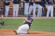 Mississippi's Taylor Hightower scores as the ball gets past  Murray State's Jason Laws in college baseball action at Oxford-University Stadium in Oxford, Miss. on Tuesday, April 27, 2010.