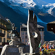 Mont Blanc (4808 meters or 15,774 feet, Monte Bianco in Italian) is the highest peak in Western Europe. Michel-Gabriel Paccard made the first ascent of Mont Blanc with Jacques Balmat in 1786, as commemorated in this bronze monument in Chamonix, France, the Alps, Europe. Chamonix (3379 feet or 1030 meters elevation) is an important world center for mountaineering.