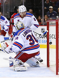 Oct 21, 2014; Newark, NJ, USA; New Jersey Devils center Adam Henrique (14) (not shown) scores a goal on New York Rangers goalie Henrik Lundqvist (30) during the second period at Prudential Center.