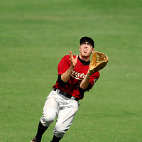 18 July 2007:  Houston Astros center fielder Hunter Pence (9) makes a diving catch on a fly ball to shallow center field in the 8th inning off the bat of pinch hitter Nook Logan.  The Nationals defeated the Astros 7-6 at RFK Stadium in Washington, D.C.  ****For Editorial Use Only****