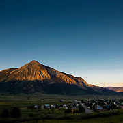 """SHOT 7/27/09 8:07:36 PM - A view of Mount Crested Butte and the town of Crested Butte, Co. A former coal mining town now called """"the last great Colorado ski town"""", Crested Butte is a destination for skiing, mountain biking, and a variety of other outdoor activities. The population was 1,529 at the 2000 census. The Colorado General Assembly has designated Crested Butte the wildflower capital of Colorado. (Photo by Marc Piscotty / © 2009)"""