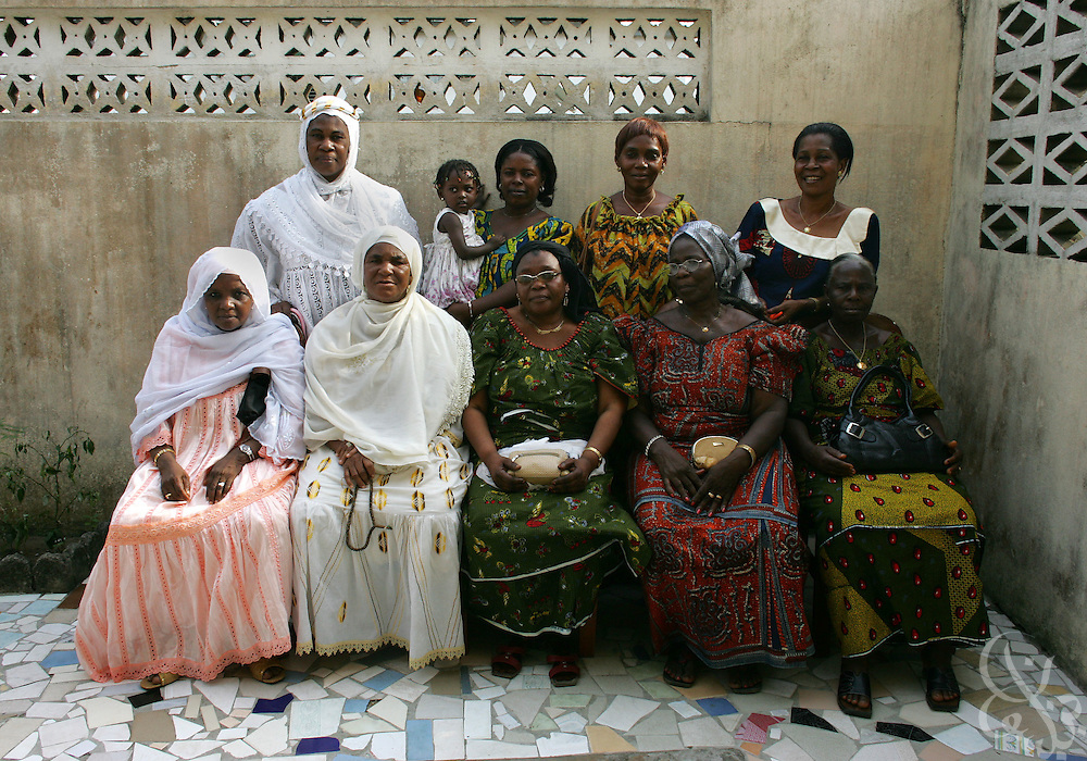 "The ""Mothers of the football playing elephants"" club poses for a group photo at the home of it's founder Alphonsine Zokora (back, right) mother of National football team member Didier ""Maestro"" Zokora February 18, 2006 in Abidjan, Ivory Coast.  Group Members (back row, left to right) Kadidja Kone, Marie-Madeleine Romaric (w/ grand daughter Naomi),Elaine Boka, Alphonsine Zokora, (front row, left to right) Mamadjo Djallo Bari, Sagnon Kone, Alizeta Dindane, Madeleine Tizie and Omou-Marie Eboue."