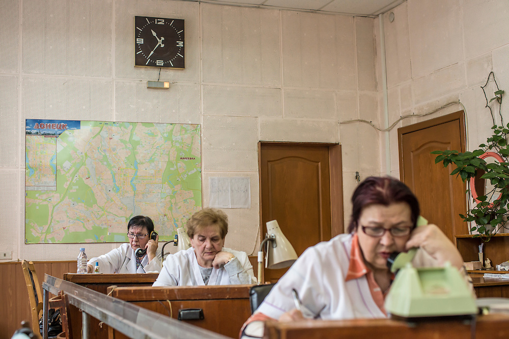 DONETSK, UKRAINE - JANUARY 28, 2015: Lidia Rihorivna, Lyudmila Aleksandrovna, and Valentina Mikhailovna, from left, answer emergency line calls in the Kyivskyi district of Donetsk, Ukraine. The area, in the city's north, is close to heavy front-line fighting around Donetsk airport. CREDIT: Brendan Hoffman for The New York Times