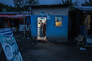 Barber shop at dusk on the main highway in Shashemene, Ethiopia.