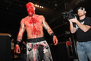 Atlanta, GA-April 2, 2011: It was an afternoon of blood, guts and spit at Center Stage for the second of two sold-out wrestling cards featuring Ring of Honor, an independent professional wrestlers club.<br /> <br /> A bloodied Jay Briscoe leaves the ring after an epic tag team match between the Briscoe Brothers and All Night Express.