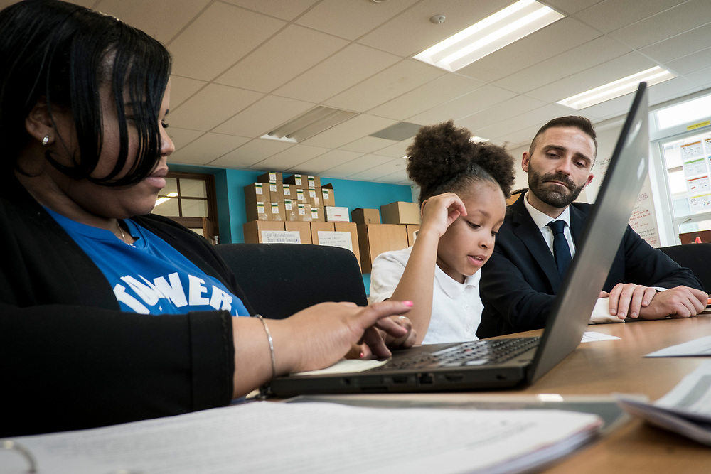 Eric Christopher, Leap ELA Instructional Coach, looks on as another teacher tests a student's reading ability and comprehension at Turner Elementary School in Washington, D.C., on Wednesday, May 4, 2017.