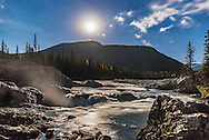 The waxing gibbous Moon over Elbow Falls on the Elbow River on a clear autumn night. <br /> <br /> This is a single 10-second exposure with the 24mm lens at f/2.5 and Nikon D750 at ISO 1000.