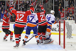 Jan 31, 2013; Newark, NJ, USA; New Jersey Devils center Ryan Carter (20) scores a goal on New York Islanders goalie Evgeni Nabokov (20) during the second period at the Prudential Center.