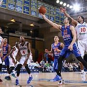 BYU alumni JIMMER FREDETTE (16) drives towards the basket as Delaware 87ers Guard RODNEY CARNEY (10) defends in the first half of a NBA D-league regular season basketball game between the Delaware 87ers and the Westchester Knicks  Saturday Dec, 26, 2015 at The Bob Carpenter Sports Convocation Center in Newark, DEL