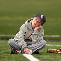 Jodi Miller.Brock Ricks, 9, Bo Ricks' younger brother, waits and watches while the Lubbock Western All-Stars practice indoors for the second day Wednesday. The team has had three days off since their win Sunday against West.