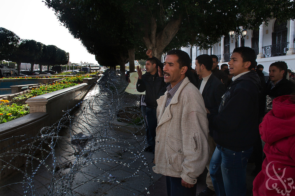 A group of Tunisian workers protests unemployment and lack of jobs during a small demonstration March 05, 2012 outside the place du Gouvernement in the Median area of Tunis, Tunisia.