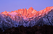Winter dawn on Mount Whitney from the Alabama Hills, Sequoia National Park, Sierra Nevada Mountains, California USA