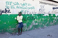 A woman cries outside a medical clinic on Wednesday, November 24, 2010 in the Cite Soleil neighborhood of Port-au-Prince, Haiti.