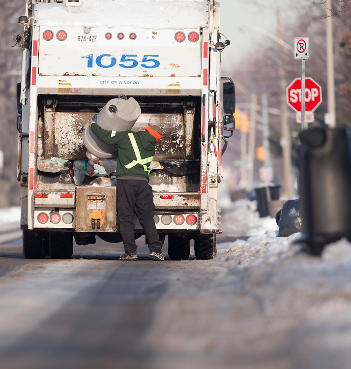 Windsor, Ontario ---10-12-16--- Will Peters of Turtle Island Recycling works on a garbage truck in Windsor, Ontario, December 16, 2010. The private company has recently taken over responsibility for garbage pickup from the city.<br /> GEOFF ROBINS The Globe and Mail
