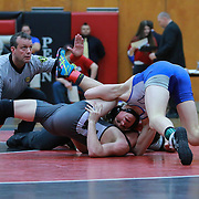 Middletown Brian Schneider, Right, and Hodgson Joey Conner grapple in a 138 pound bout during the Blue Hen Conference Wrestling Tournament Finals Saturday, Feb. 20, 2016 at William Penn High School in New Castle.