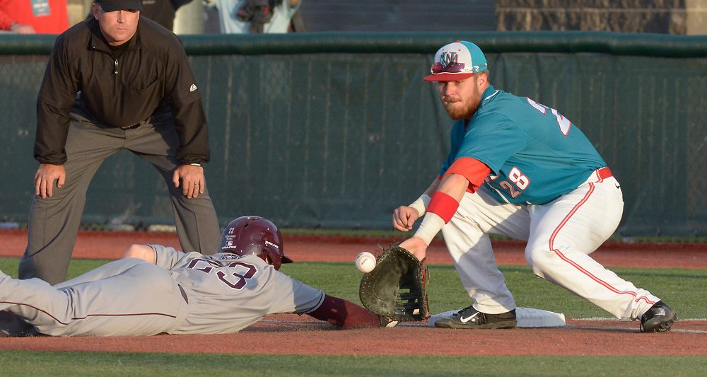 gbs041317i/SPORTS --  UNM first baseman Jack Zoellner catches the throw from the pitcher but the tag on Missouri State's Jack Duffy is late in the second inning of the game at the Santa Ana Star Field on Thursday, April 13, 2017. (Greg Sorber/Albuquerque Journal)
