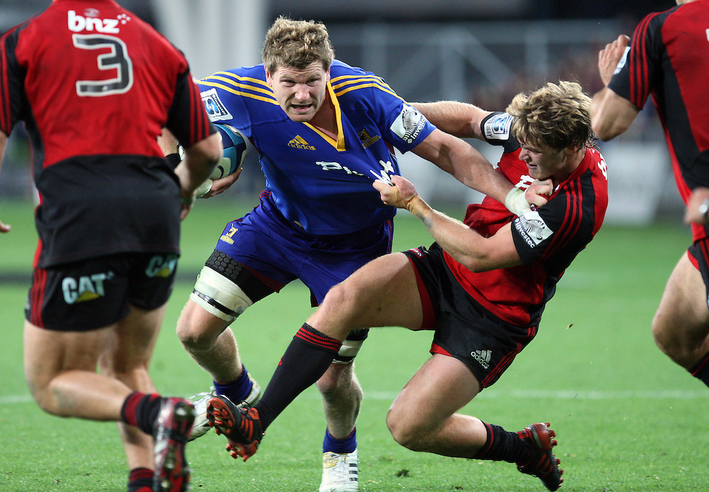 Highlander's Adam Thomson, left, in the tackle of Crusader's Tyler Bleyendaal in the Super 15 rugby match at Forsyth Barr Stadium, Dunedin, New Zealand, Saturday, March 03, 2012. Credit:SNPA / Dianne Manson