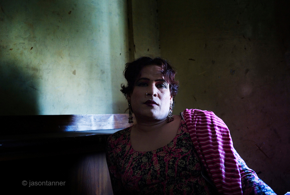 Sheza Shahnawaz, a 42 year old Hijra is the Guru (leader) of the Hijra community in the deprived suburb of Agra Taj in Karachi. ..The word Hijra is an Urdu word meaning eunuch or hermaphrodite. However, most Hijras in Pakistan are gay men who leave home to join the Hijra community as young boys where there is more acceptance. Most identify themselves as more feminine then masculine and dress and act accordingly...Although tolerated in a country where homosexuality is against the law, Hijras are largely ostracised from society. They are often denied work opportunities, rejected by most families, lack formal education and live in poorer areas of the city...They share similarities with the more famous Hijra communities in the Indian subcontinent and Bangladesh. In a continent where great emphasis is placed on one's ability to have children, those who are unfortunate not to be able to conceive children are not considered a true man or woman. Life for many Hijras in Pakistan consists of begging for alms (Zakat) in the more prosperous areas of the city as well as slums in addition to receiving alms when bestowing blessings on male babies and at weddings....Most Hijras dress as women, and engage in activities such as dancing and entertaining in public - activities that would be considered inappropriate for women of the subcontinent. Some members of the community engage in prostitution. .