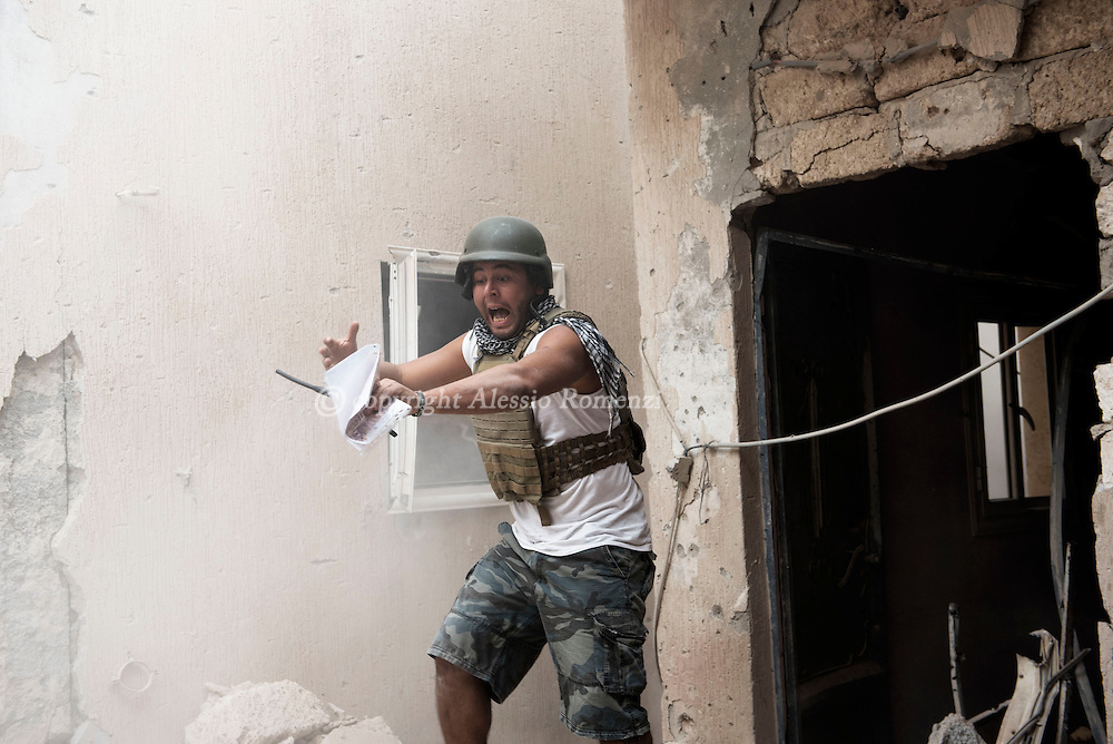 Libya, Sirte: A fighter of the Libyan forces affiliated to the Tripoli government is seen in a heightened emotional state as moments before one of his comrade got killed by an ISIS suicide bomber in Al Jiza neighbourhood on November 26, 2016.  Alessio Romenzi