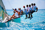 """356204-1173B ~ Copyright:  George H. H. Huey ~  """"Lonesome Dove"""" sailing to windward with crew riding the pry. National Family Island Regatta. George Town, Great Exuma Island, Bahamas."""