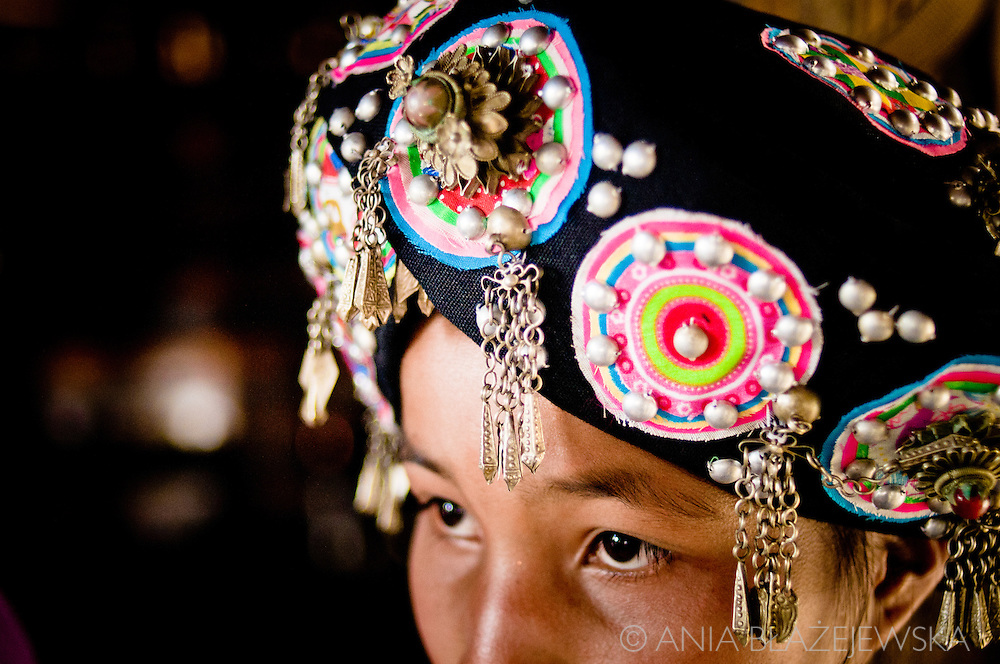 Laos, Muang Sing. Beautiful Lolo headdress. Lolo people are one of the minorities living in the north of Laos.