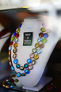 Necklace made of Murano glass with guarantee certificate in shop display window, Murano, Venice, Italy