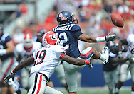 Ole Miss' Donte Moncrief (12) can't hold on to a pass as Georgia cornerback Sanders Commings (19) defends at Vaught-Hemingway Stadium in Oxford, Miss. on Saturday, September 24, 2011. Georgia won 27-13.