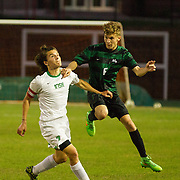 #6 J.P. Junglen challenging the header against Irish #7 Matteo Hernandez - Nicholas Rutledge / For The Transcript