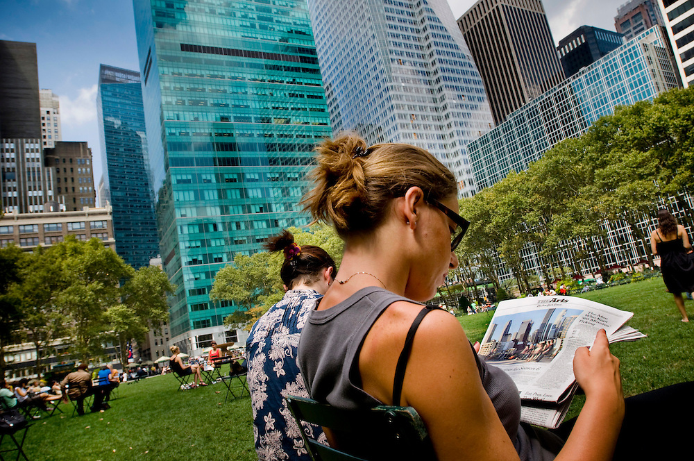 Crisis in the newspaper industry.  New Yorkers and their news reading habits...Maria Nanna, reading the New York Times in Bryant Park..Photographer Chris Maluszynski /MOMENT