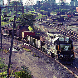 Returning to the steel mill with empty molten steel 'bottle' cars, a Norfolk Southern local freight picks its way through the Arcelor Mittal Steel Mill yard trackage in East Chicago, IN.