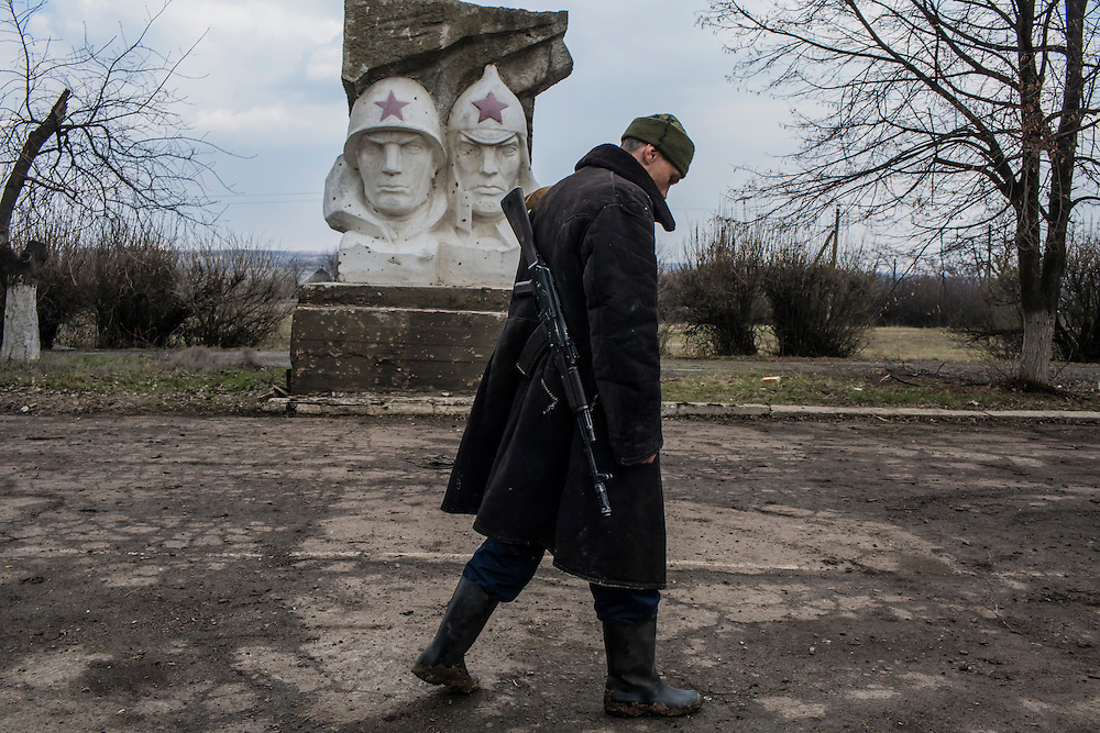 A soldier for the Donetsk People's Republic at a front-line position in an abandoned school on Wednesday, March 23, 2016 in Zaitseve, Ukraine.