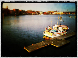 """Lobster boat on Badger's Island in Kittery, Maine. Shot from the US 1 Memorial Bridge between Kittery, Maine, and Portsmouth, New Hampshire. iPhone photo - suitable for print reproduction up to 8"""" x 12""""."""