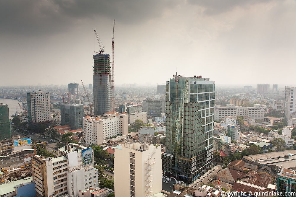 Construction of Bitexco Financial Tower and Sun Wah tower From the top floor of the Sheraton Hotel, Central Ho Chi Minh City ,Vietnam