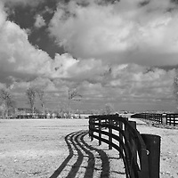 Plainfield Farm horse pasture in rural Kentucky - fence with clouds.  Infrared (IR) photograph by fine art photographer Michael Kloth.