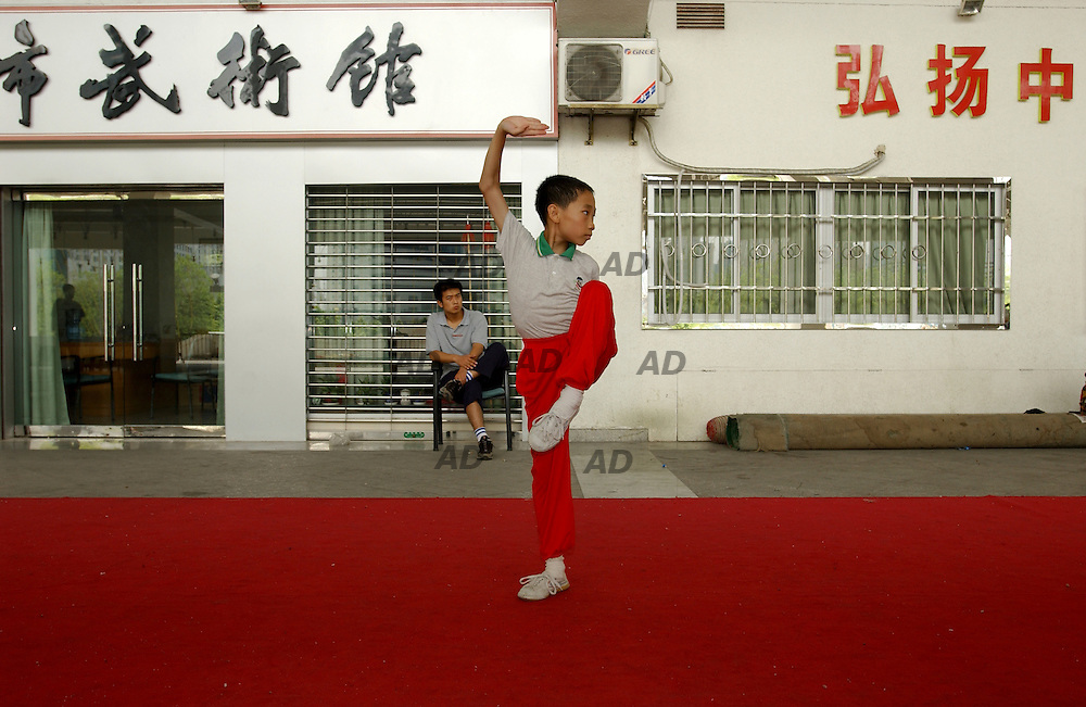 Thai-chi training in Tianhe sporting center.