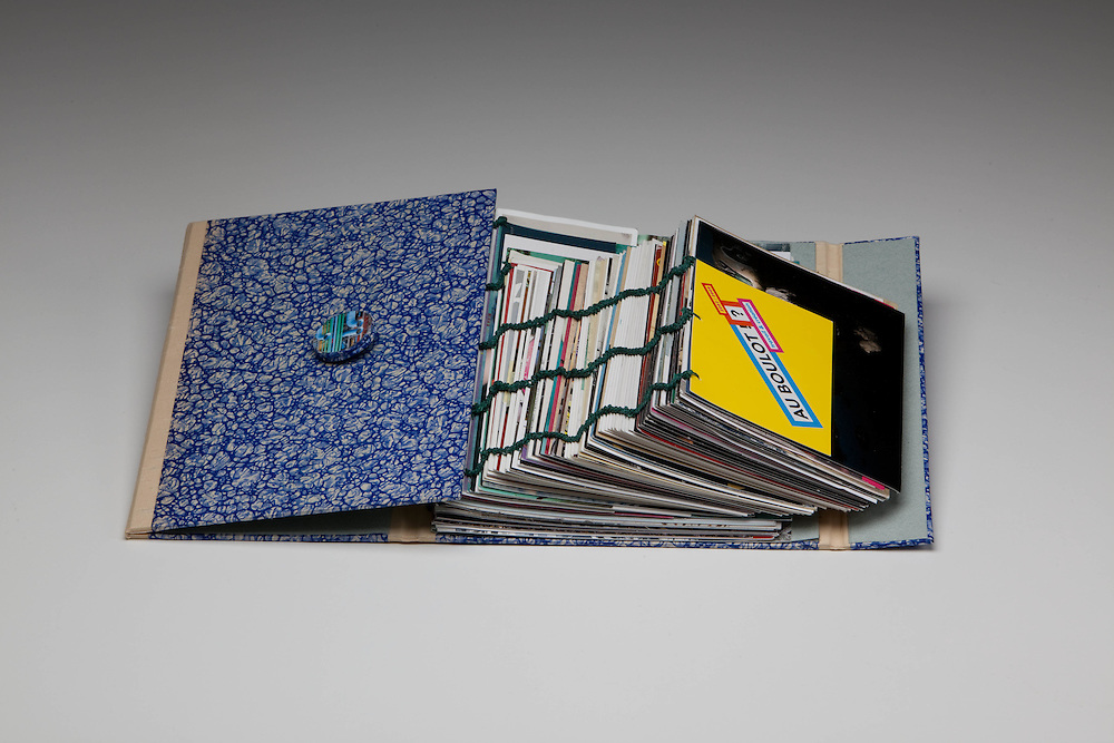 Stack of postcards sewn as single sheets.