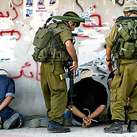 Israeli soldier round up and arrest Palestinians as they are lined up against a wall in handcuffs and blindfolds in the West bank village of Salfit on Friday, 15 July 2005. Earlier Israel struck against islamic Jihad militants outside this village killing two in an airborne missile attack...PHOTO BY Olivier Fitoussi / BauBau.