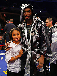 October 18, 2008; Atlantic City, NJ, USA;  Bernard Hopkins poses with his daughter after his 12 round Light Heavyweight fight against Kelly Pavlik at Boardwalk Hall in Atlantic City, NJ.  Hopkins won the fight via 12 round unanimous decision.