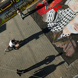 Baha Al-Qidra, a Palestinian artist, paints a large banner of Yasser Arafat, Gaza, Palestinian Territories, Nov. 9, 2004. Residents of Gaza say they are in shock from the news of Arafat's deteriorating condition. Arafat was diagnosed with liver failure while in critical condition in a Paris hospital.