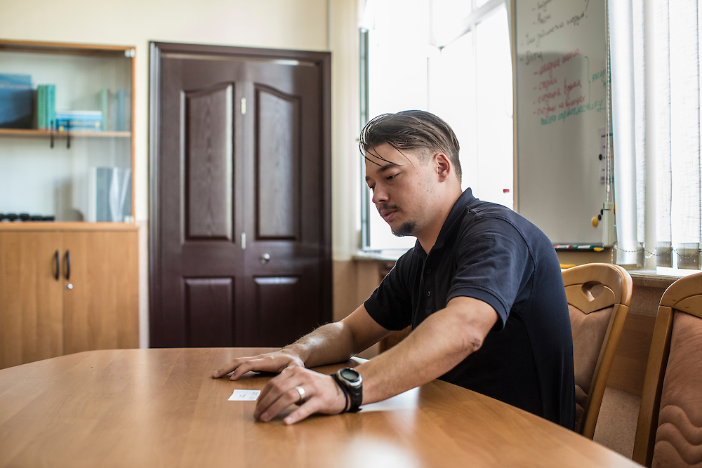 LVIV, UKRAINE - SEPTEMBER 15, 2015: Yuri Zozulya, 26, chief of the new Lviv police, sits for an interview in his office in Lviv, Ukraine. In an effort to reform the notoriously corrupt Ukrainian police force, an entirely new force has been established in several cities, including Kiev and Lviv, with a primary focus on patrolling the streets. CREDIT: Brendan Hoffman for The New York Times