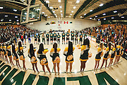 The teams line up to listen to the singing of the National Anthem before the start of the women's basketball game between the UMBC Retrievers and the Vermont Catamounts at Patrick Gym on Saturday afternoon January 17, 2015 in Burlington, Vermont. (BRIAN JENKINS, for the Free Press)