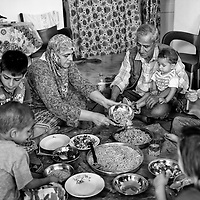 Egypt / Syrian refugees / Syrian refugee Moazez Masri, 50-years-old, originally from Homs serves dinner for her family in their rented apartment in Beit Al Alia neighborhood in the 6th of October City outside of Cairo, Egypt, Monday, May 27, 2013. Moazez's family left Homs 1 year and a half ago, stayed in Latakia for 9 months and has been displaced several times. 'We had to leave because the situation was very bad, raids, no water, no electricity, no food. We didn't have any choice but to go'.  / UNHCR / Shawn Baldwin / May 2013