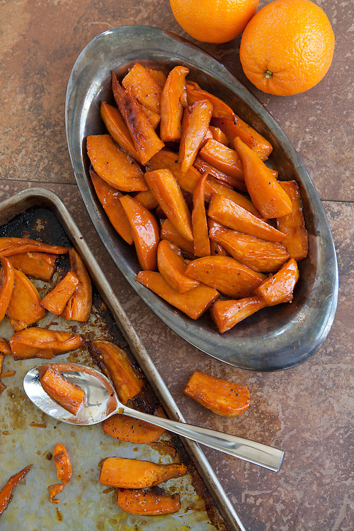 Roasted Sweet Potatoes in a serving dish along with the baking sheet.