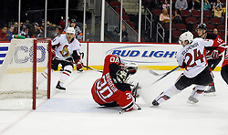 February 13, 2008; Newark, NJ, USA;  Ottawa Senators defenseman Anton Volchenkov (24) has his shot go off New Jersey Devils goalie Martin Brodeur (30) and just over the crossbar during the first period at the Prudential Center in Newark, NJ.