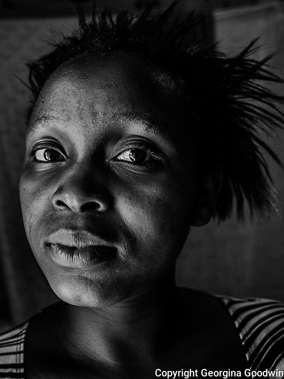 Anne Wangeshi, aged 19. Raped in December 2012 by two men, friends of her boyfriend. She has only shared with 4 friends and her boyfriend but does not have the courage to report to the police. Her father died last year and her mother does not know about the incident. <br /> This image is from a series focusing on and around the rape and the women victims that occur every half a day in Mugumoini Village in Nairobi's Southlands, a slum home to 20,000 people in abject poverty with little or no income, with the aim of creating exposure and empowerment for change. &copy;GGoodwin